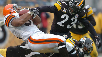 Defensive back Tyrone Carter makes the hit on Browns running back Jamal Lewis. (vs. Browns 11/11/07)