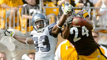 The Steelers&#039; Ike Taylor tries to intercept a ball intended for Seahawks receiver Deion Branch in the first quarter yesterday.