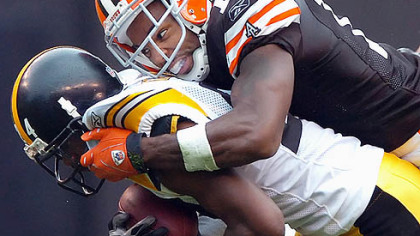 Ike Taylor is tackled after intercepting a ball intended for the Browns Braylon Edwards Sept. 9.