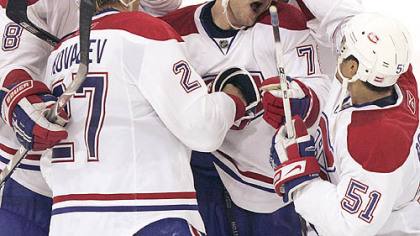 Montreal's Andrei Markov is mobbed by teammates after scoring the winning goal in the eighth round of the shootout at Mellon Arena.