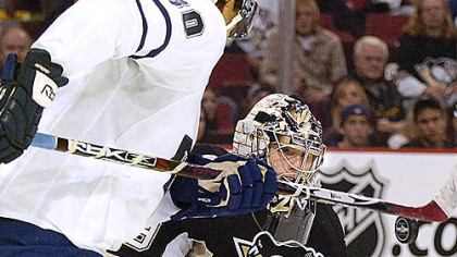 Marc-Andre Fleury makes save against the Leafs Nic Antropov.