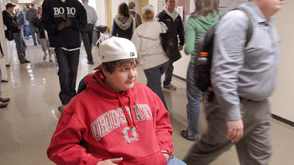 Ryan Ballou waits in a hallway for class at Edinboro University. After a difficult first year in which he nearly flunked out, Ryan, of Ben Avon, has returned to the school, determined to raise his grades.