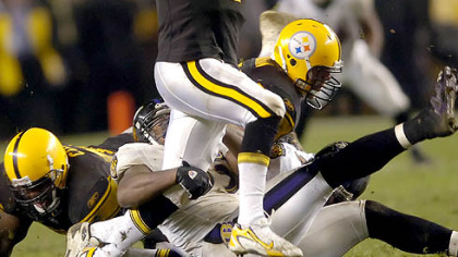 Quarterback Ben Roethlisberger scrambles as he tries to avoid a sack in the second quarter. (vs. Ravens, 11/05/07)