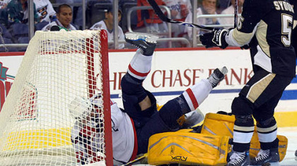 Washington Capitals' Michael Nylander, left, of Sweden, falls over Penguins goalie Marc-Andre Fleury as Darryl Sydor (5) looks on during the first period last night in Washington.