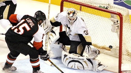 Penguins goalie Dany Sabourin is unable to stop a shot by the Flyers' Joffrey Lupul for a first-period goal Tuesday night in Philadelphia. Lupul earned a hat trick by scoring two more goals against the Penguins.