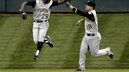 Pirates center fielder Nyjer Morgan (29) celebrates with teammate Steve Pearce (18) after catching a long fly ball hit by Houston Astros' Ty Wigginton with the bases loaded during the third inning of last night's game in Houston. Morgan made the catch for the final out of the inning.