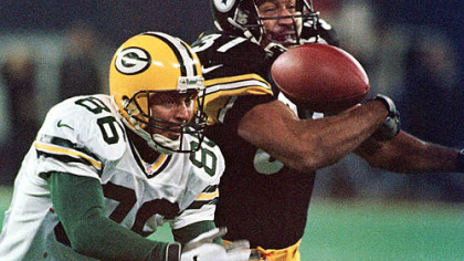 Steelers cornerback Carnell Lake reaches for a pass tipped by Green Bay Packers Antonio Freeman, 1998.