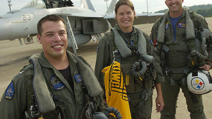 Lt. John Lynn, left, Lt. Meagen Varley  and Cmdr. Tim Gamache, who will coordinate the fly-by from the ground, arrive at the Pennsylvania Air National Guard 171st Air Refueling Wing.