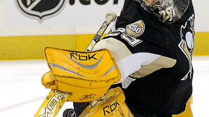 Marc-Andre Fleury makes a save.