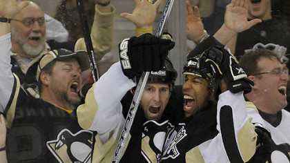 Georges Laraque celebrates after scoring in the second period against the Bruins at the Mellon Arena. (12/23/2007)