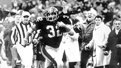 "Franco Harris gives a goodbye look to an Oakland Raiders defender as he streaks down the sidelines for the winning touchdown after his ""Immaculate Reception"" in the 1972 AFC playoffs."