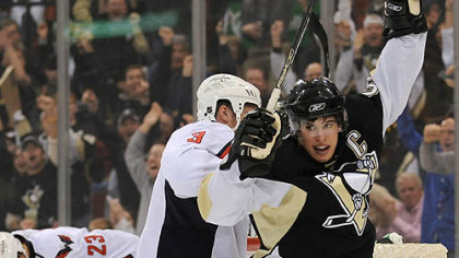 Sidney Crosby celebrates first period goal by teammate Colby Armstrong.