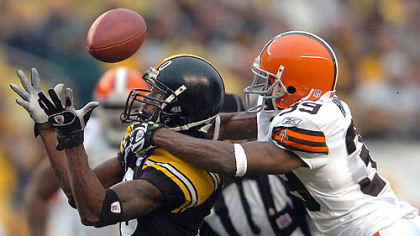 Browns' cornerback Daven Holly breaks up a pass to wide receiver Santonio Holmes in the 4th quarter. (vs. Browns 11/11/07)
