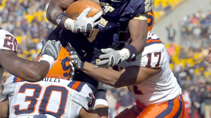 LeSean McCoy's 140 yards rushing put him over 1,000 for the season == the first Pitt back since 2000 to top 1,000.