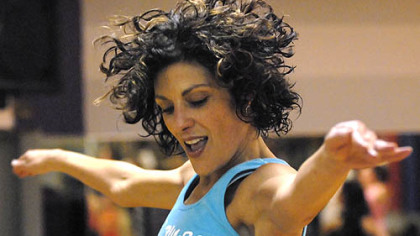 Maria McCalister leads a Zumba aerobics exercise class at Club 1 in Shadyside last month.