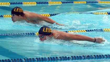 Dan Eckel, 20, and Doug Dietrich, 17, work on their butterfly stroke at the Mt. Lebanon municipal pool. Both qualified for the 200 butterfly at the Olympic trials next year.