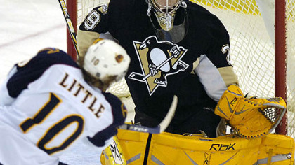 Goaltender Marc-Andre Fleury makes a save on a shot by the Thrashers&#039; Bryan Little in a game Nov. 24. Fleury has had two consecutive strong starts for the Penguins.