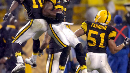 Wide receiver Santonio Holmes and linebacker James Farrior celebrate with teammate defensive back Anthony Smith after he recovered a fumble in the second quarter.(vs. Ravens 11/05/07)