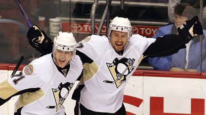 Evgeni Malkin, left, and Petr Sykora celebrate after Sykora scored against the Flyers in the first period.