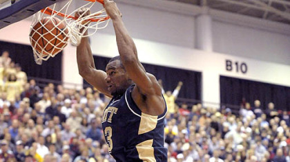Pitt's Sam Young dunks in front of Duquesne's Aaron Jackson last night at the Palumbo Center. (at Dukes 12/05/2007)