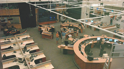 A view of the Channel 11 newsroom from a second-floor conference room.