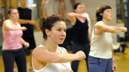 Anna Uskova, center, works out at Maria McCalister's Zumba aerobics exercise class at Club 1. An anesthesiologist at UPMC Shadyside, Dr. Uskova also lifts weights and takes yoga.