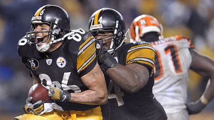 Hines Ward celebrates with Willie Colon after scoring his second touchdown of the night in the third quarter, breaking John Stallworth's team career touchdown receptions record. (vs. Bengals 12/02/2007)