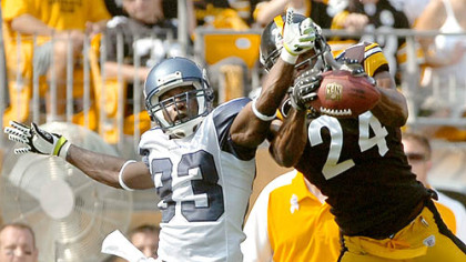 Cornerback Ike Taylor tries to intercept a ball intended for Seahawks wide receiver Deion Branch.