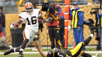 Browns wide receiver Joshua Cribbs gets around Steelers kicker Jeff Reed as he runs a kickoff back 90 yards to the Steelers 3. (vs. Browns 11/11/07)
