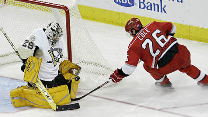 Goalie Marc-Andre Fleury blocks a shot by the Carolina Hurricanes' Erik Cole in the second period of the Penguins' season opener last night.